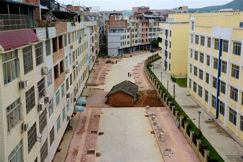 China's nail houses: Defiant homeowners who refuse to