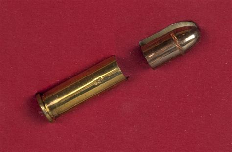 Lot Detail - Bullet and Spent Cartridge from the Gun Used