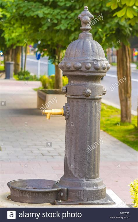 Public drinking water tap on street Stock Photo, Royalty