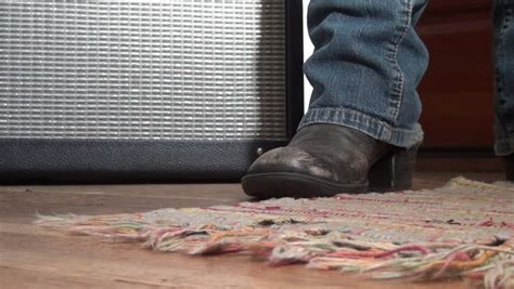Cowboy Boot Taps Out A Beat In Front Of A Vintage Amp In A